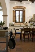 Dining area in an open kitchen of an old mediterranean country home