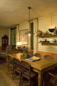 Wooden table with wicker chairs in a country style dining area