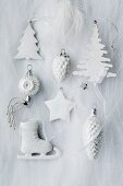 Assorted Christmas tree decorations in white