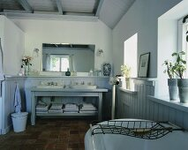 A bathroom with two wash basins in a country house