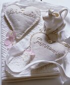 An embroidered scented pillow and a frog-shaped milk jug