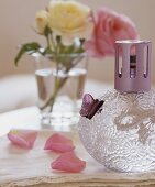 A fragrance lamp and rose petals