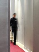 Elegant hotel corridor with blurred person in background