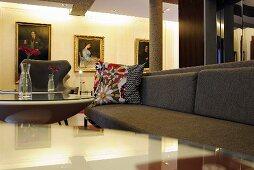 A grey sofa with colourful cushions in an elegant hotel reception