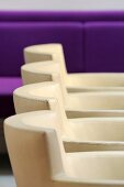 Detail of a row of white leather chairs