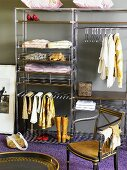 Dressing room with antique chair and open metal shelves