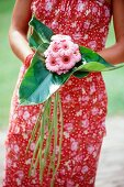Hand holding a small bunch of gerberas