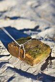 A brick in sand