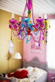 A chandelier with brightly coloured beads