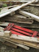 Old wood and a red palette on a stone floor