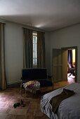 Darkened bedroom with a terracotta floor