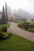 Foggy morning -- Mediterranean countryside and natural stone houses
