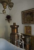 Oriental bathroom with an antique copper stove