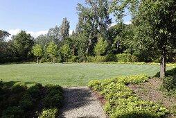 Freshly mowed circular lawn in the garden