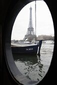 View through a porthole of the Eiffel tower