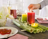 Table decoration on a laid table with coloured candles