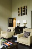 Natural coloured armchairs and small art deco-style furniture with overhead light