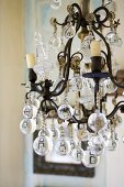 An antique wrought-iron chandelier with glass balls