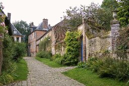 A brick-built town house and a stone wall on a old village street