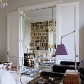 A mirror in a doorway making the room look bigger