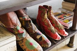Hand-made, embroidered fabric shoes from Afghanistan on a shelf