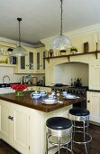 Breakfast for two on a kitchen counter in a light-painted kitchen in a country house