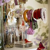 Bracelets and necklaces on a jewellery stand