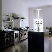 An open-plan kitchen in a period building with a free-standing kitchen counter