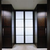 A wardrobe made of tropical wood with double glass door