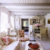 A living room in a 19th century German thatched-roof house decorated in a Scandinavian style