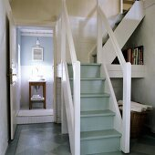 A staircase with a bathroom in the background - 19th century German thatched-roof house decorated in a Scandinavian style
