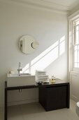 A designer washstand with a mirror in the bathroom of a country house