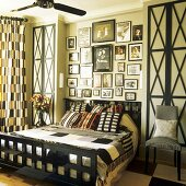 A bed with a black wooden grid-patterned frame and built-in bedside tables