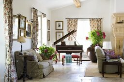A Mediterranean living room with sofas and a piano