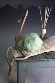 A bath sponge, a massage band and room scent