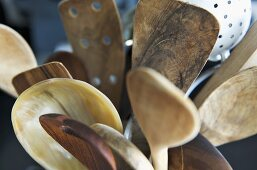 Assorted wooden spoons and spatulas
