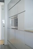 Integral oven in fitted units in modern kitchen