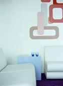 Pale blue seating and table in hotel foyer