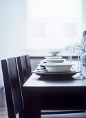 Monochrome table setting on black dining table
