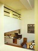 Elevated view of kitchen with mezzanine floor above