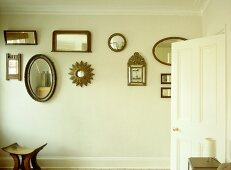 Collection of various mirrors displayed on wall