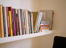 A detail of a book shelf,