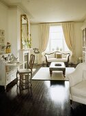 A traditional, white sitting room, polished wood floor, painted bureau, gilt chair, upholstered armchair, rug, open curtains,