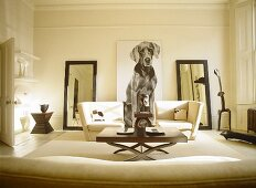 Cream sitting room with large picture of dog with matching mirrors on either side.