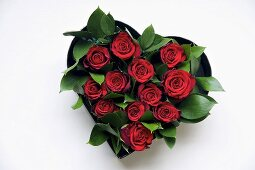 Red roses in a heart-shaped bowl