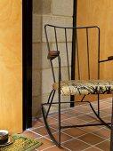 A metal rocking chair