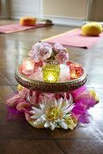 Table decoration with flowers and a tea light in a yoga studio