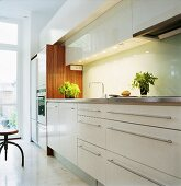 A kitchen with white cupboards