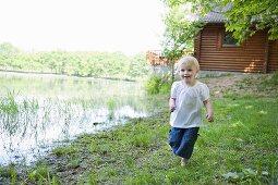 A little girl by a lake