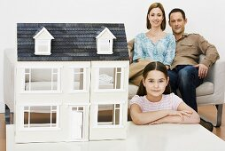 Family with model house